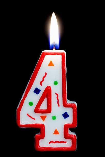 Number Four Birthday Candle Stock Photo