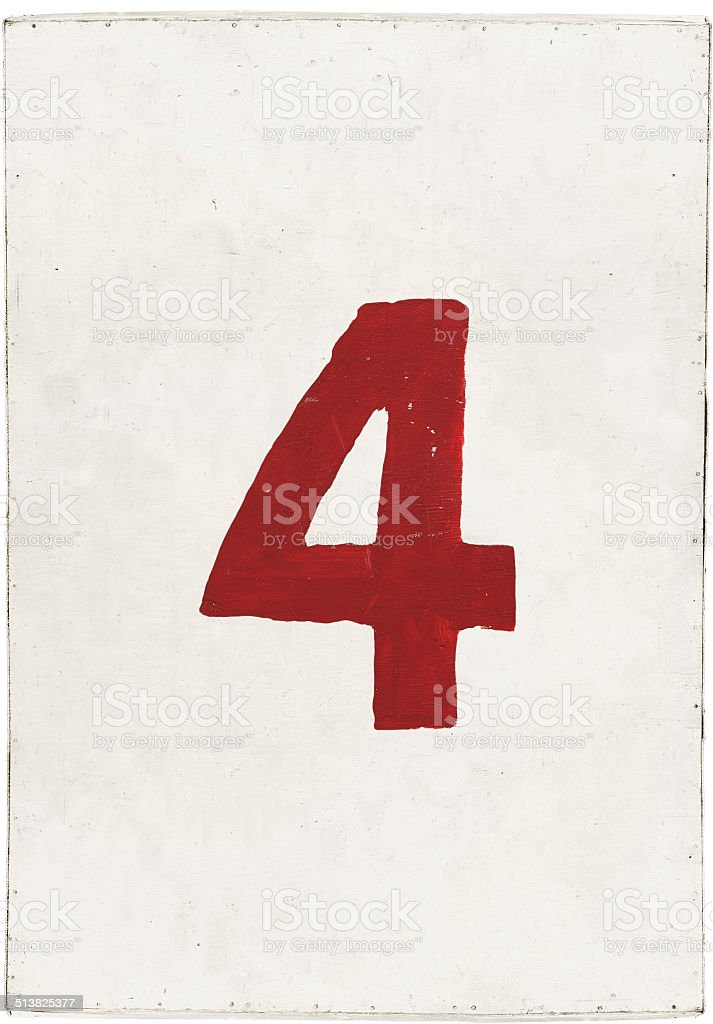 number four on white plywood board stock photo