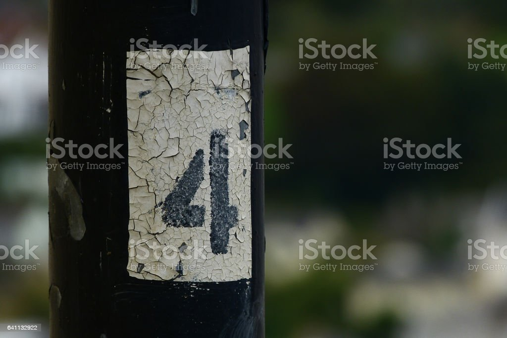 Number four painted on pylon Number four painted on pylon Electricity Pylon Stock Photo