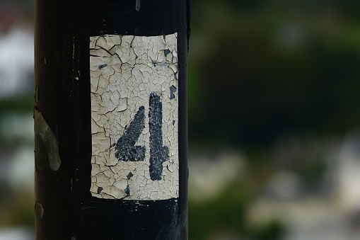 Number Four Painted On Pylon Stock Photo - Download Image Now