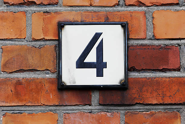 Number four Sign with house number four on a red brick wall. number 4 stock pictures, royalty-free photos & images