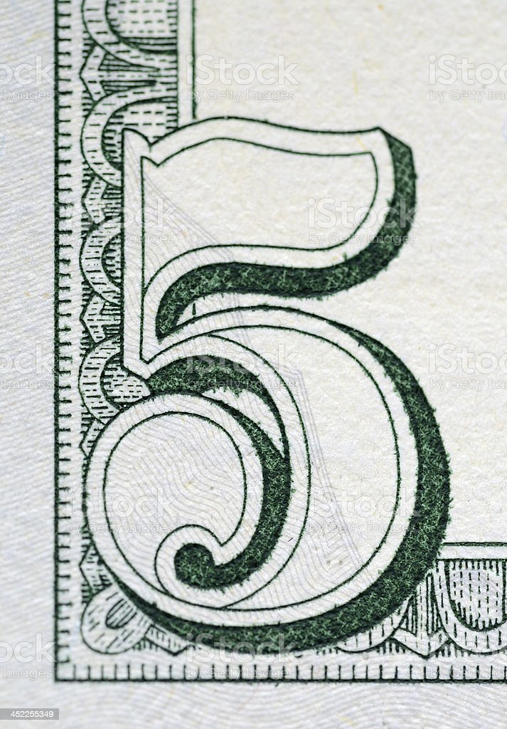 Number in the corner of a five dollar bill stock photo