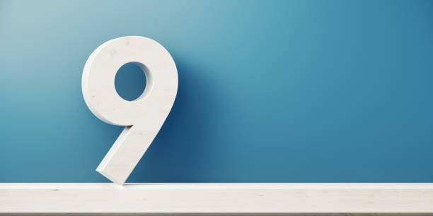 Number Nine In Front Of Blue Wall stock photo