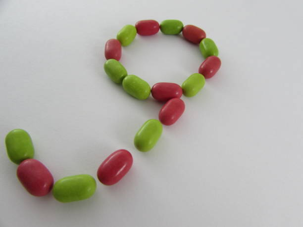 number nine made from multicolored mints - 8 infographic stock photos and pictures