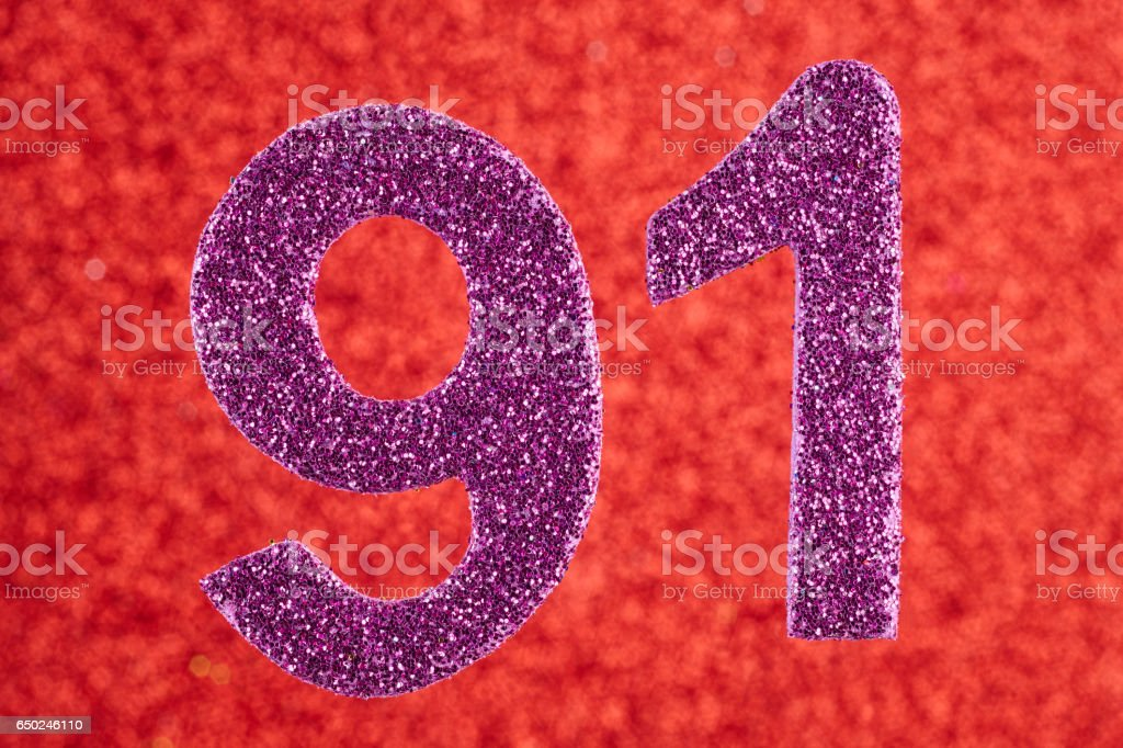 Number ninety-one purple color over a red background. Anniversary. stock photo