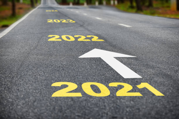 Number of 2021 to 2024 on asphalt road surface with white arrow Business success concept and happy new year idea forecasting stock pictures, royalty-free photos & images