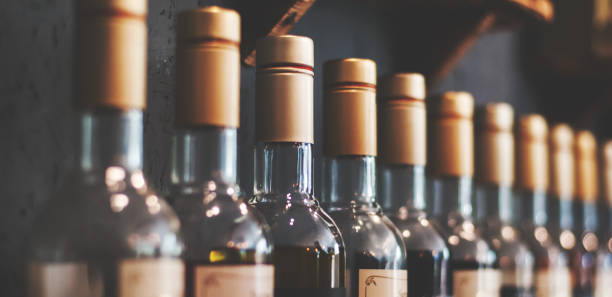 number-of-bottles-with-drinks-on-the-shelf-picture-id875530834?k=6&m=875530834&s=612x612&w=0&h=FApU2kC7_yQrVhAxawfPV7aOj0Hlii4Z9Tig0YNNVrA=