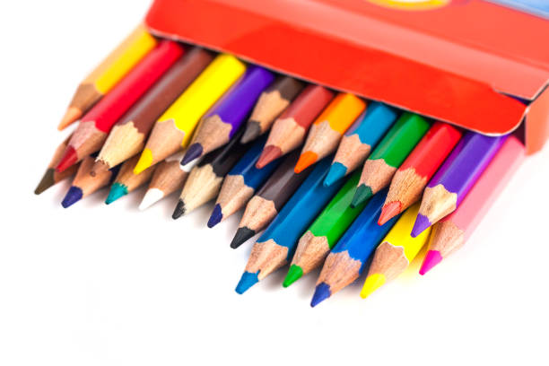 Number of colored pencils in a box isolated on white background stock photo