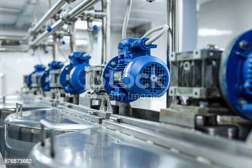 istock A number of electric motors with reducers. Tanks for mixing liquids 876873662