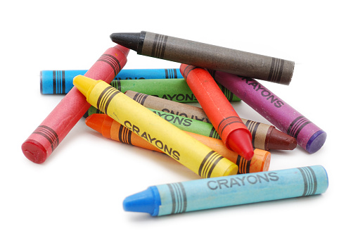 Crayons lying in chaos isolated on white backgrond