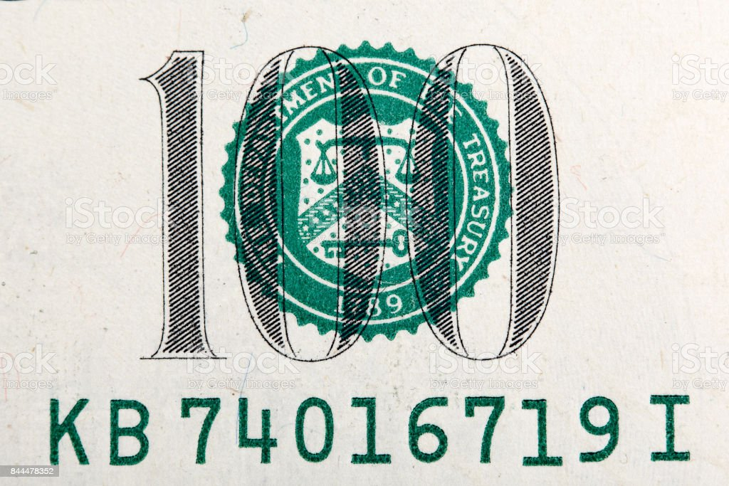 Number of one hundred dollar bill in macro stock photo