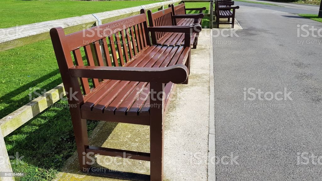 number of park benches in a staggered row stock photo