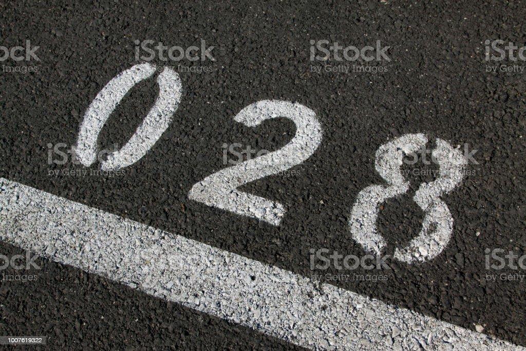 Number on Asphalt Pavement
