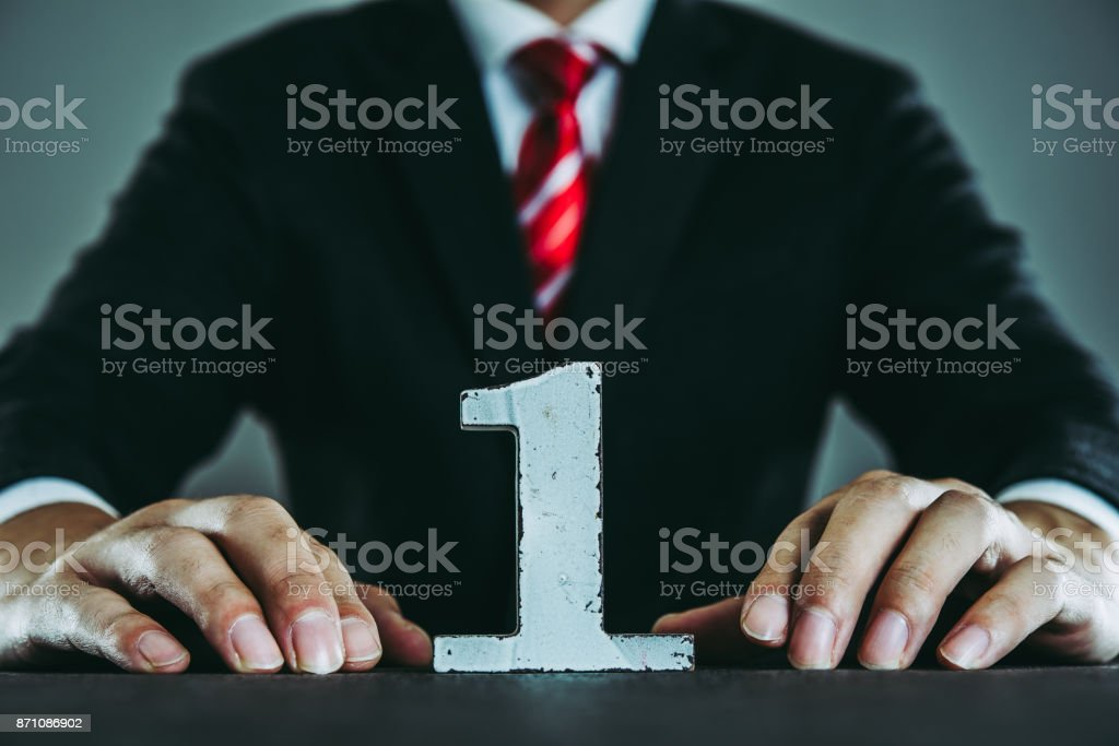 Number one and businessman stock photo