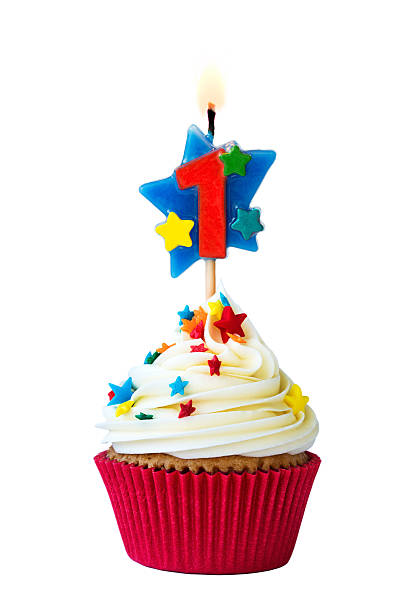 Number one cupcake Cupcake with number one candle first birthday stock pictures, royalty-free photos & images