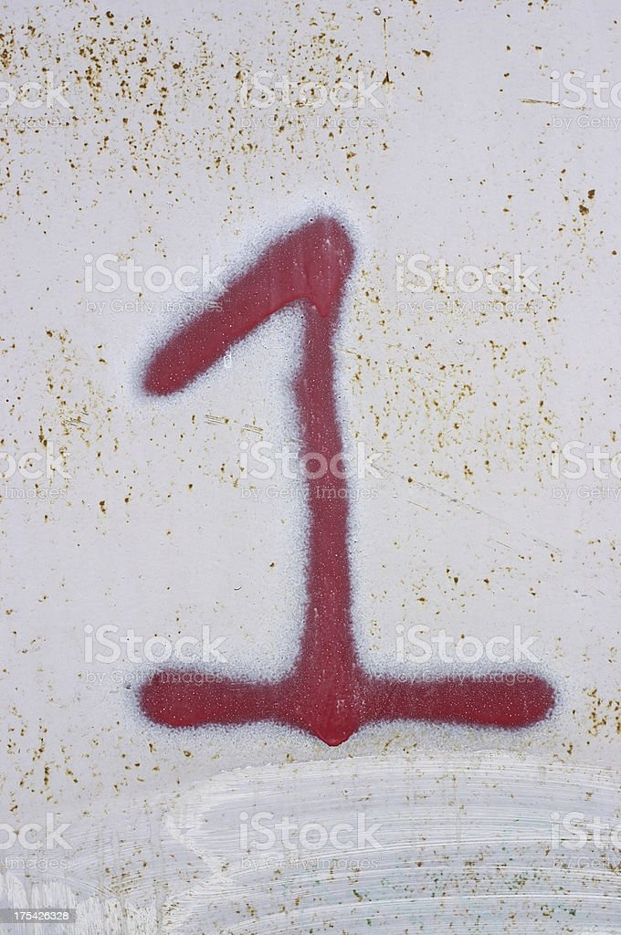Graffiti red number one stock photo
