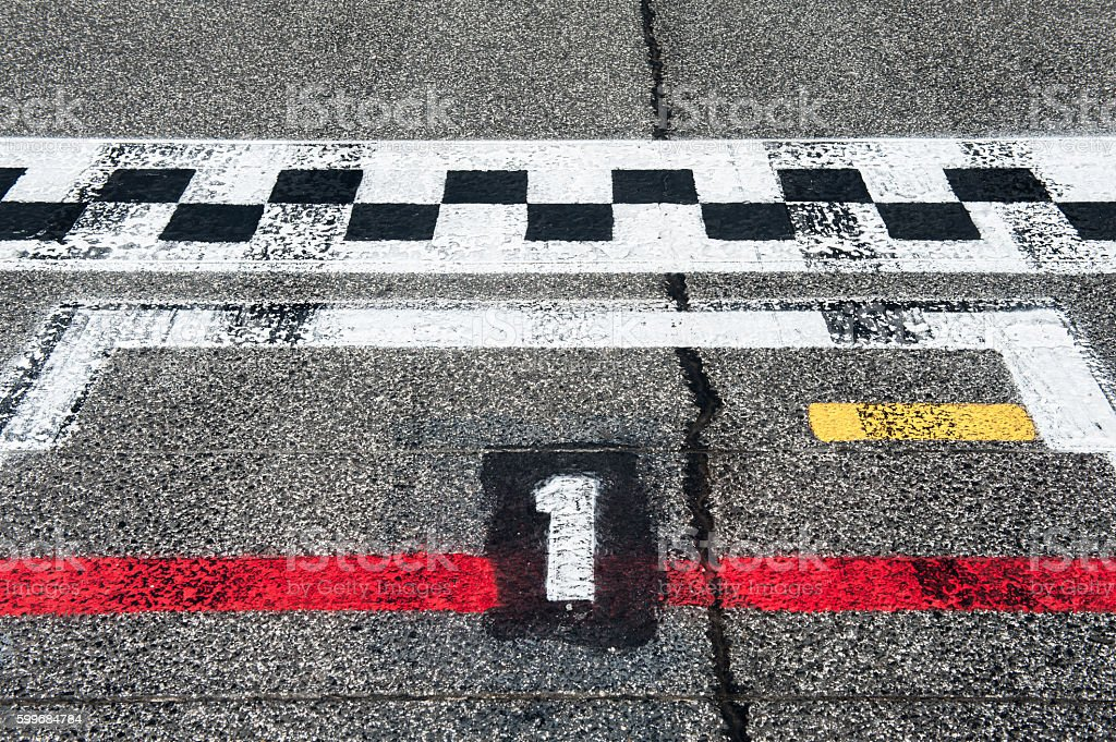 Number one pole position on speedway starting track stock photo
