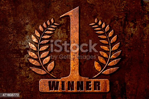 istock Number One winner concept on metal rust background 471603772