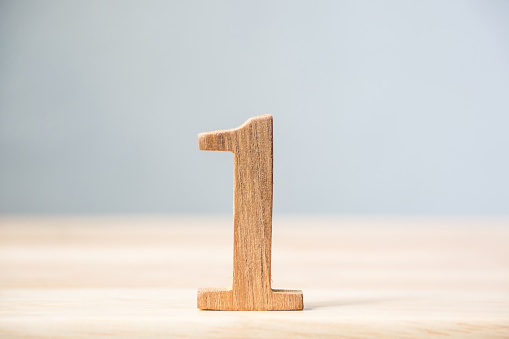 istock Number one wood material on table, Concept top winner success 842083046