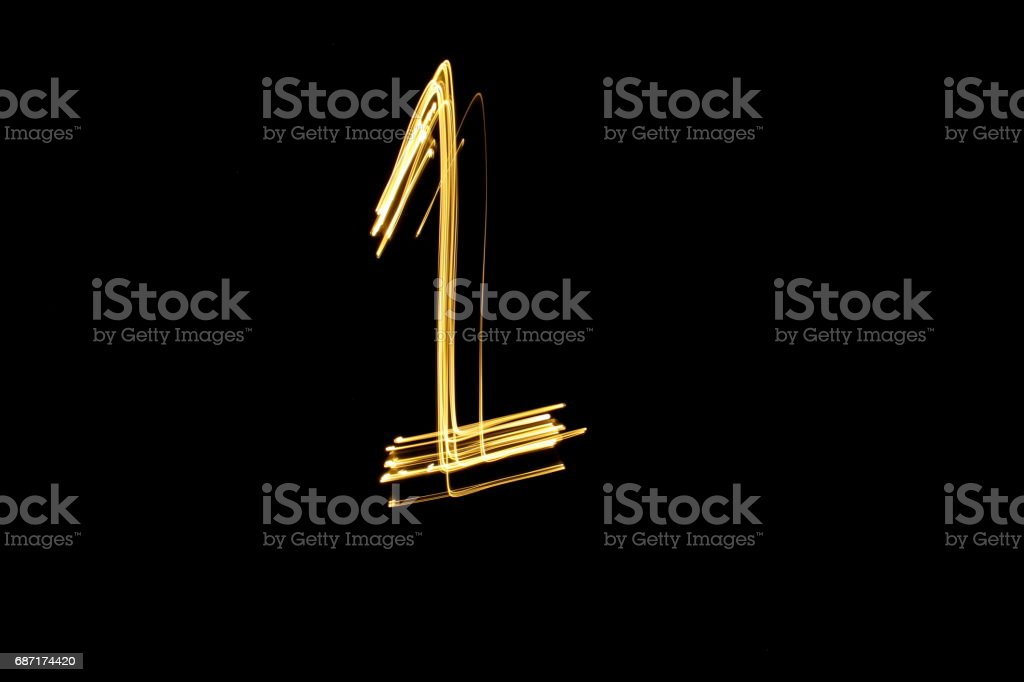 Number Series - Number 1 - Gold Light Painting Photography against a black background stock photo