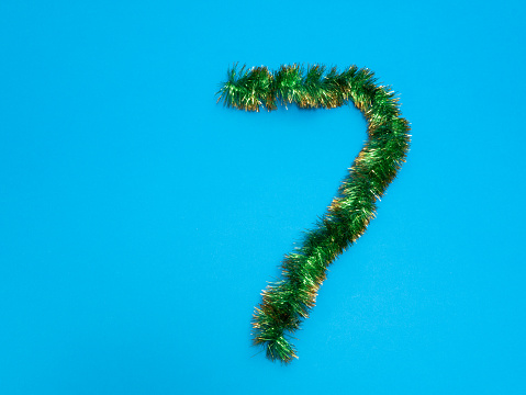 istock number seven 7 made of green tinsel on blue background 1084196174