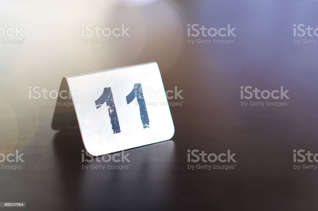 Number sign on restaurant table to show reservation. Customer waiting for service or food. stock photo