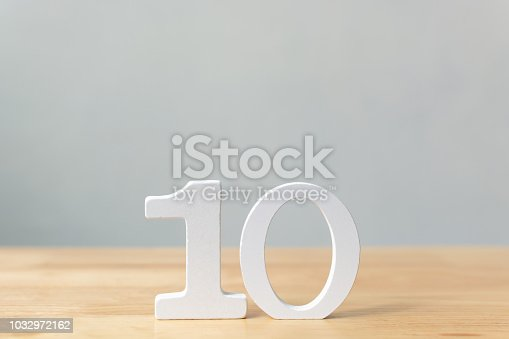 Number ten wooden material on table with copy space