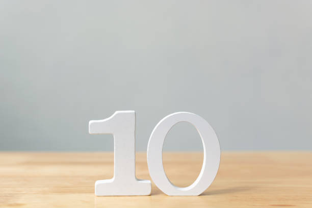 Number ten wooden material on table with copy space Number ten wooden material on table with copy space high section stock pictures, royalty-free photos & images