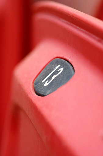 171581046 istock photo Number Thirteen on stadium seat. Seat number of stadium seats. Numbers tell the seats of those who came to watch sports. Empty plastic seats in a stadium. Matches to be played without fans. 1226954653