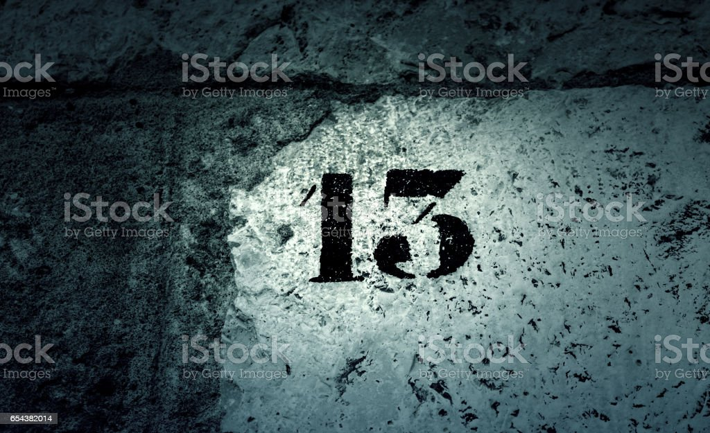 Number thirteen wall stock photo