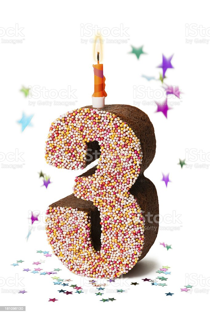 Number three chocolate birthday cake with lit candle royalty-free stock photo