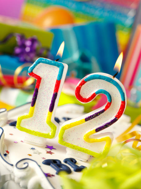 Number Twelve Birthday Candle Stock Photo