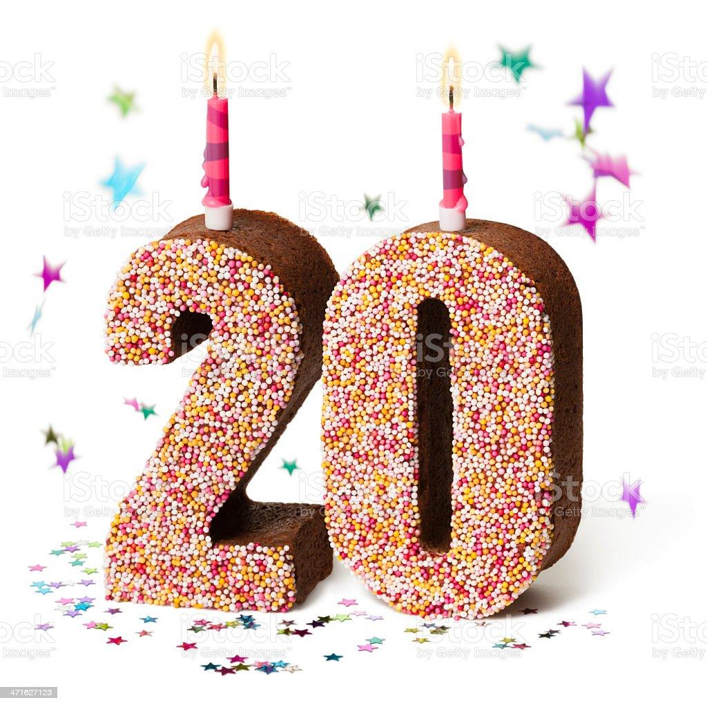 Number twenty chocolate birthday cake with lit candles stock photo