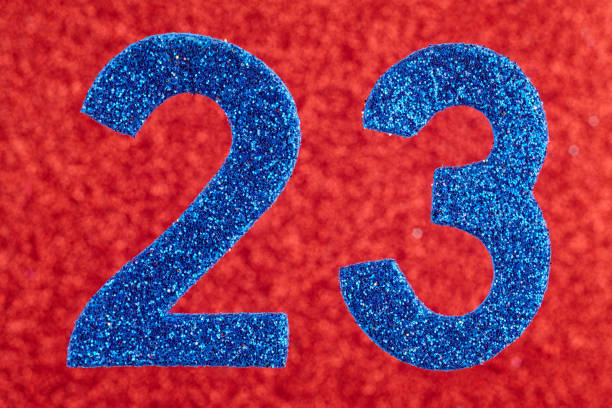 number twenty-three blue over a red background. anniversary. - number 23 stock photos and pictures