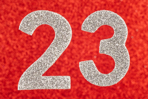 number twenty-three silver over a red background. anniversary - number 23 stock photos and pictures