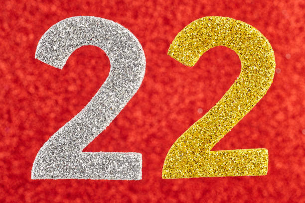 Number twenty-two silver gold over a red background. Anniversary. stock photo