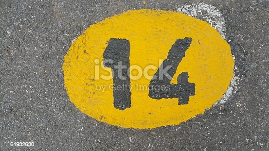 istock Number yellow painting wallpaper 1164932630