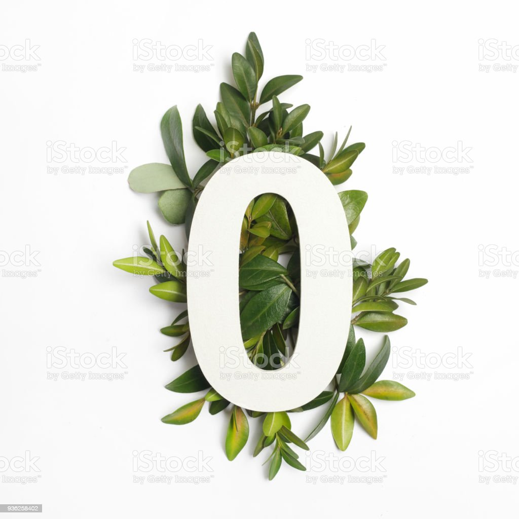 Number zero shape with green leaves. Nature concept. Flat lay. Top view stock photo