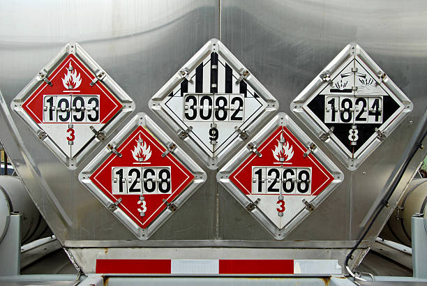 Numbered black and red transportation placards USDOT Hazardous Materials Transportation Placards on rear of a Fuel Tanker toxic waste stock pictures, royalty-free photos & images