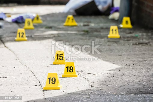Numbered cones mark evidence after two pipe bombs exploded.
