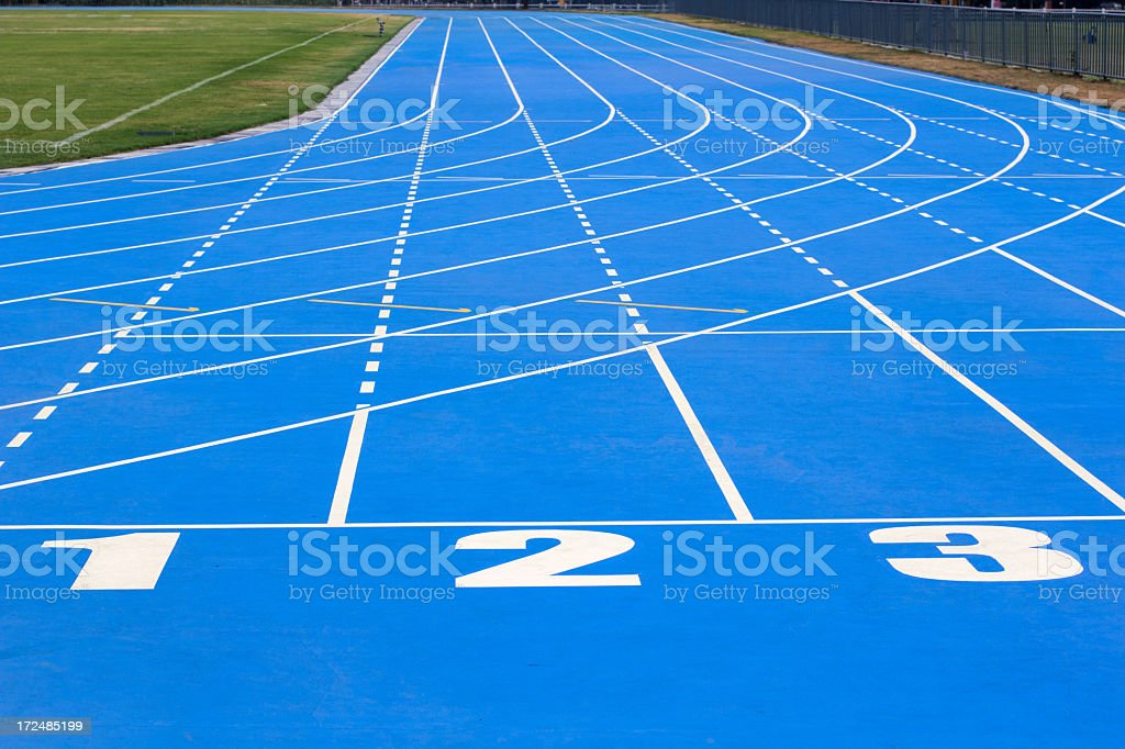 Numbered lanes on a running track royalty-free stock photo