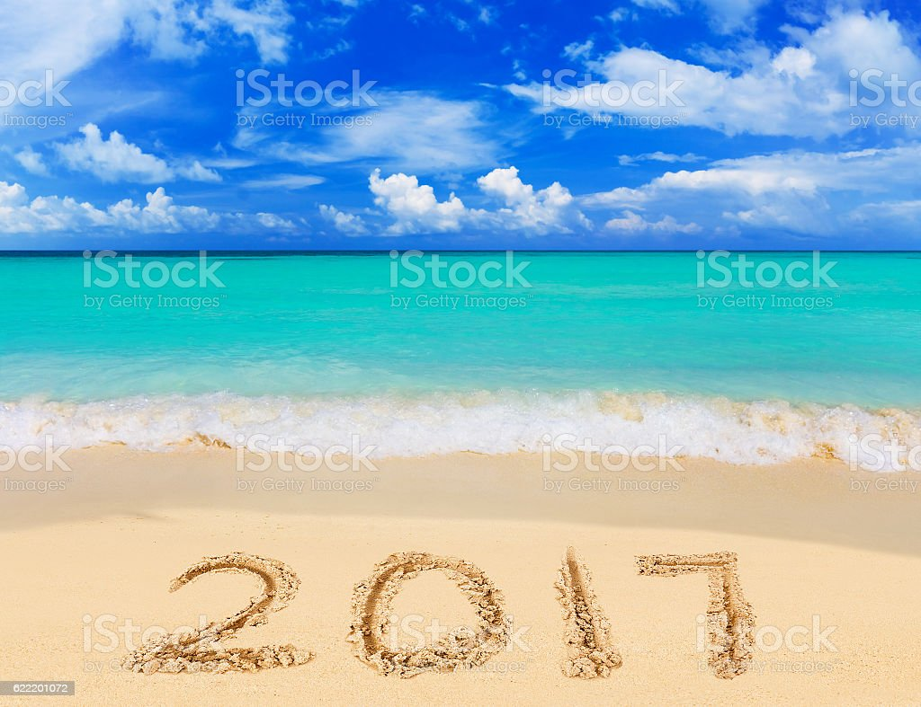 Numbers 2017 on beach stock photo