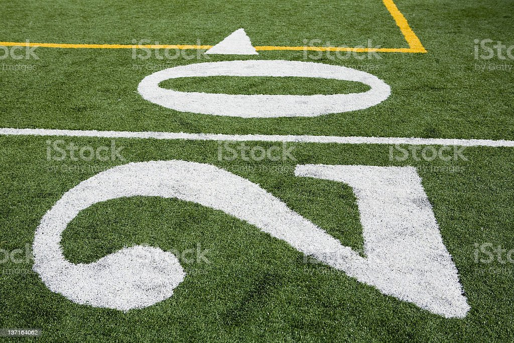 Numbers on a football field stock photo