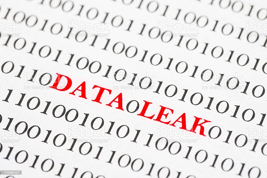 Numbers on a piece of paper with data leak in red stock photo
