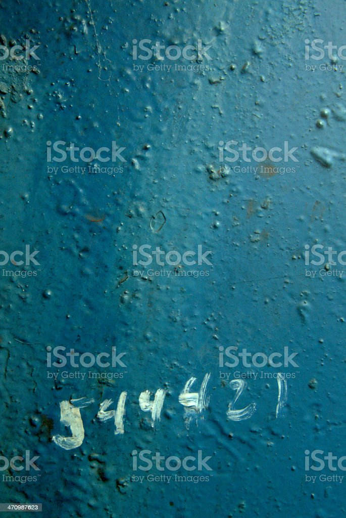 Numbers on blue metal stock photo