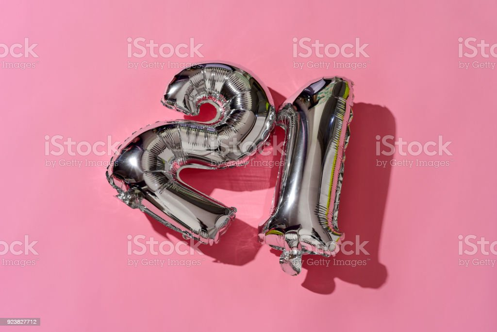 number-shaped balloons forming the number 21 stock photo