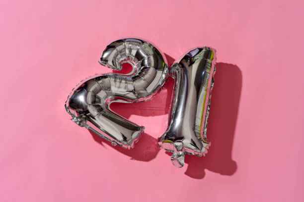 number-shaped balloons forming the number 21 - number 21 stock photos and pictures
