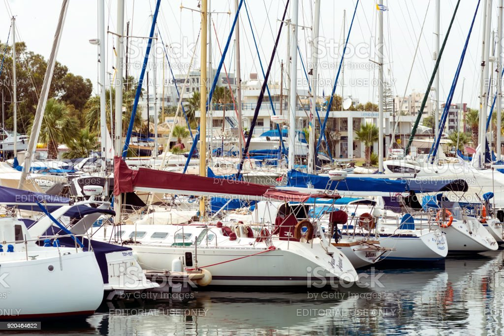 Numerous fishing and yachts moored in marina stock photo