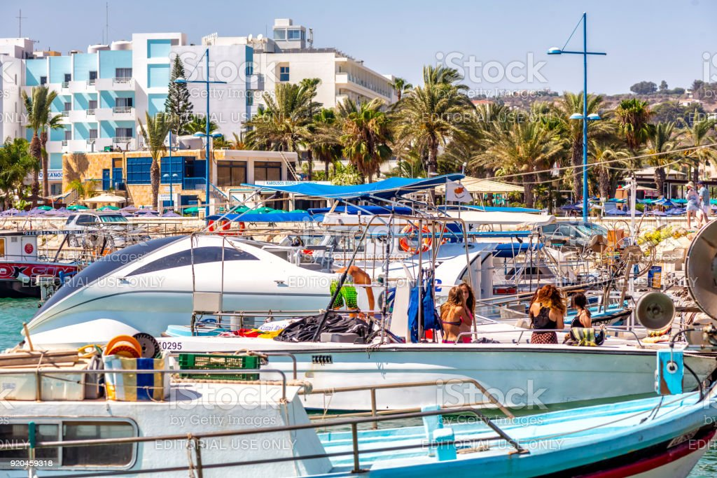 AYIA NAPA - JULY 16, 2016: Numerous fishing boats and yachts in port of Ayia Napa stock photo