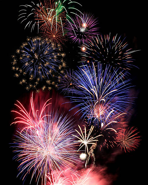 Numerous large and colorful fireworks stock photo